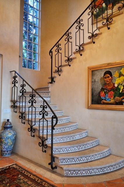 Beautiful Spanish Style wrought Iron railing on stone steps with hand painted tiles.   Elegant Villa Staircase. Mexican Home Style.  #Mediterranean Home.  Spanish Colonial Home