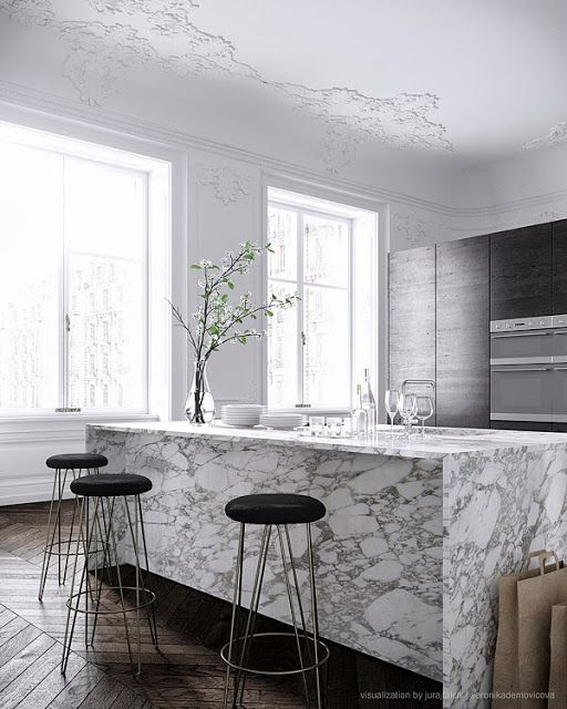 Modern Grey Parisian Kitchen. Is that a marble slab waterfall island I see? That's pretty!