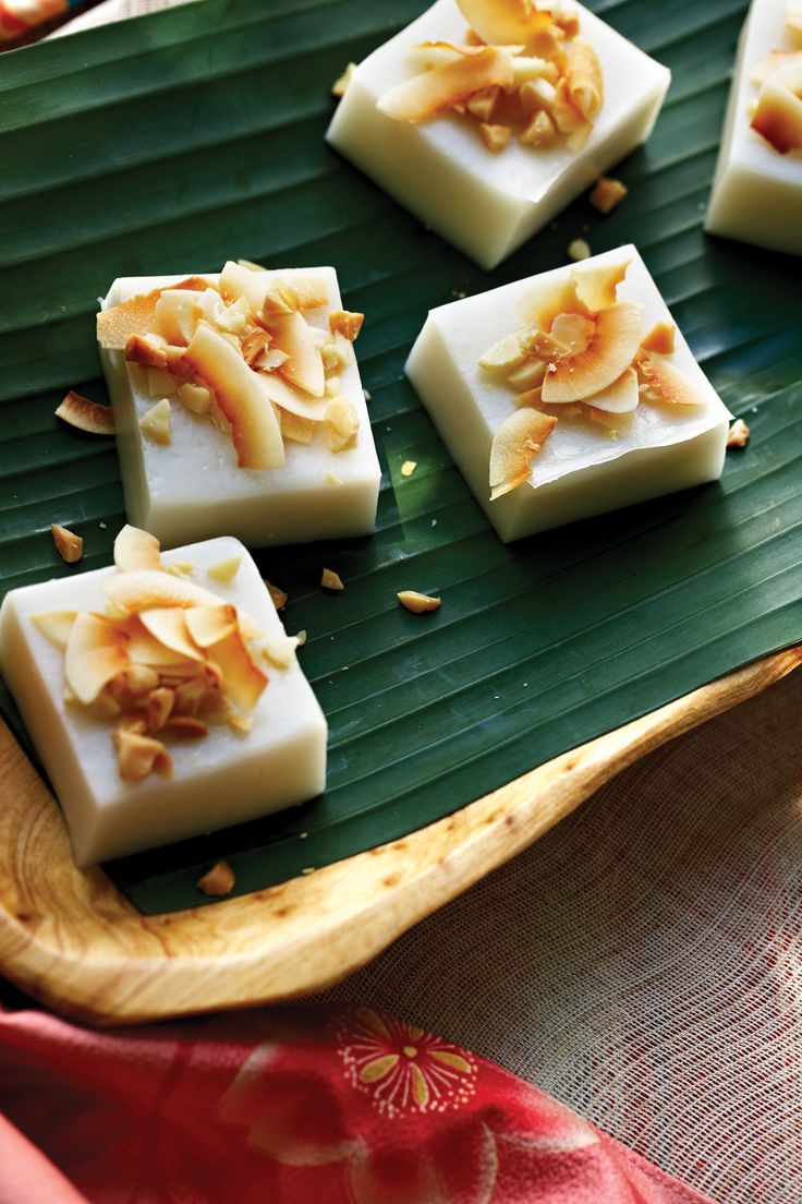 Haupia Coconut Pudding - a vegan coconut pudding. This quintessential luau dessert is sliced into petite squares and served on small pieces of ti or banana leaf. Serve with a large platter of tropical fruits (such as sliced mango, pineapple, and papaya). Beautiful dessert for any summer party. #vegan