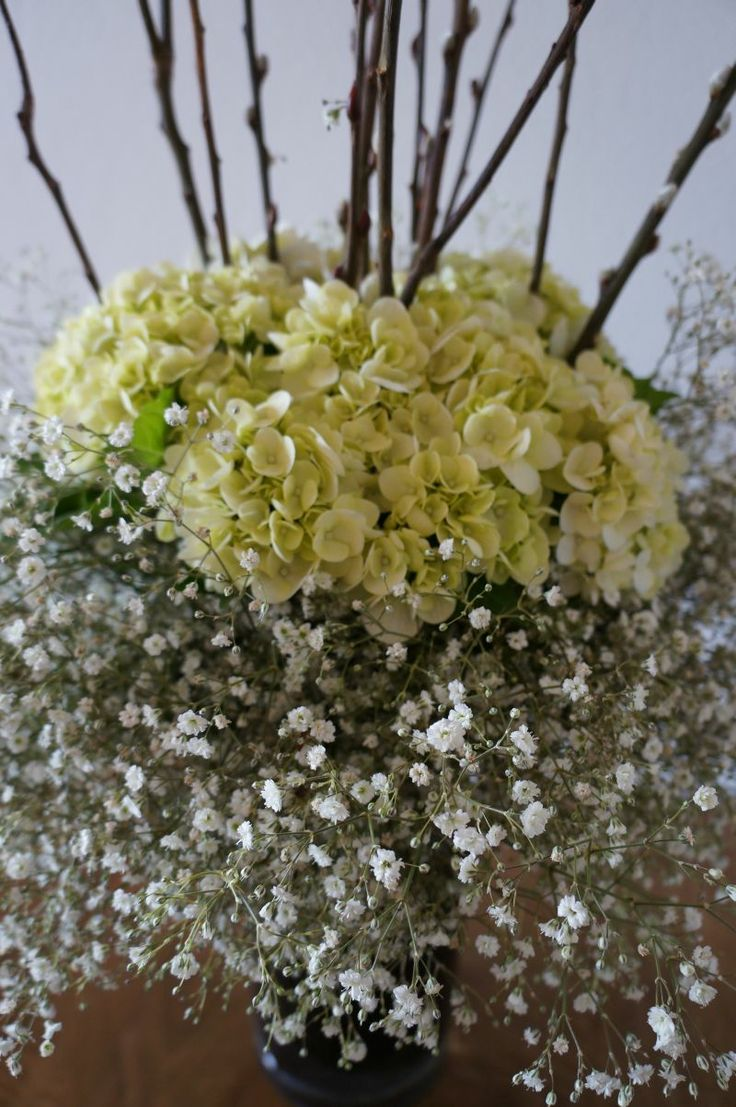 Soft and flowy altar arrangements