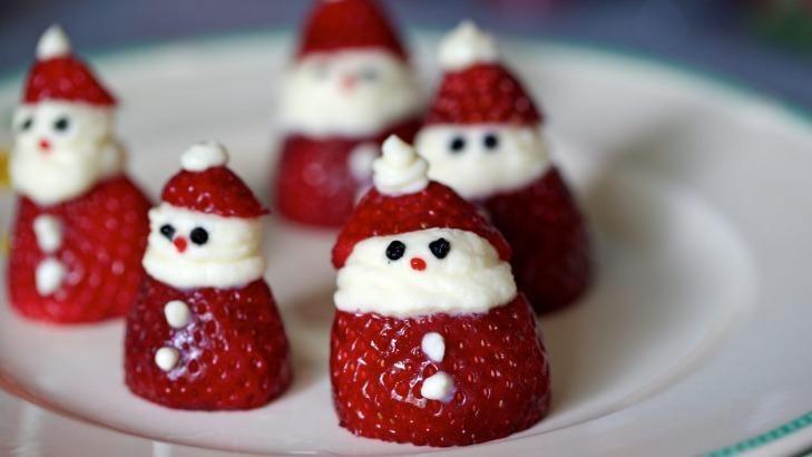 Strawberry Santas :  http://www.goodfood.com.au/good-food/christmas-feasts/how-to-make-strawberry-santas-20141219-12ajg3.html