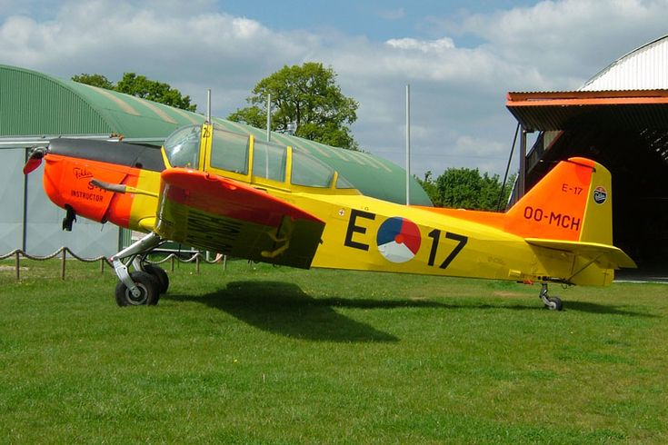 OO-MCH Fokker S-11.1 Instructor c/n 6208 - Royal Netherlands Air Force E-17 colours - Hoogeveen airfield in Holland - 17 May 2004.Instructor is a single engine, two-seat side-by-side primairy trainer with a fixed tailwheel undercarriage.