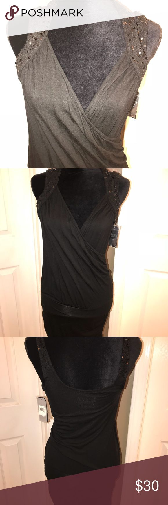 Sexy Guess dress Fitted super sexy Guess dress perfect for the new year!!  No snags 94% Rayon 6% Spandex Smoke free home bundle for discounts offers are welcome 😀 Guess Dresses Mini
