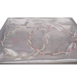 Χειροποίητα Ασημένια 925 Στέφανα Γάμου με Λευκές Πέρλες & Swarovski Ροζ Λουλουδάκια. Μοντέρνο και ιδιαίτερο σχέδιο! Το ένα στέφανο είναι απλό με λευκές πέρλες ενώ το άλλο είναι με λευκές πέρλες και λουλουδάκια ροζ Swarovski. Για σας που την πιο όμορφη μέρα της ζωής σας θέλετε να είναι όλα ξεχωριστά και ιδιαίτερα... Ασυνήθιστα όμορφα..!