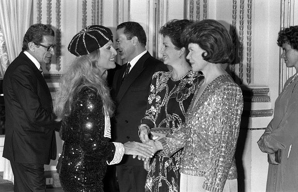 Egyptian President Hosni Mubarak speaks with Egyptian film Director Youssef Chahine while Danielle Mitterrand and Mubarak's wife Suzanne shake hand...