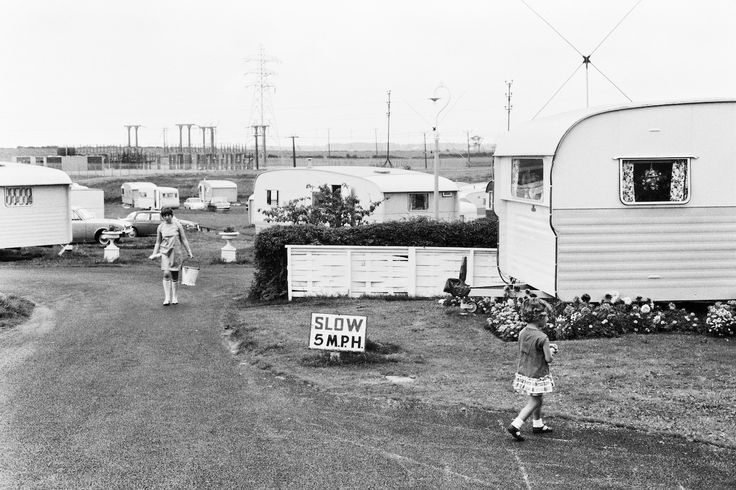 Blackpool, Tony Ray-Jones, 1967. Only in England would you find a caravan, holiday destination next to an electricity sub-station.