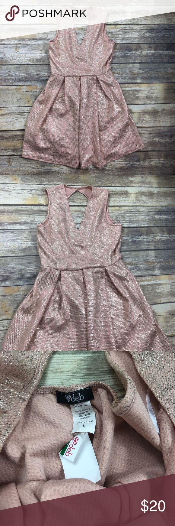 Pink and Silver Night Out Dress Great dress for a party! Light pink with silver throughout. New with tags and has never been worn. Size large. Length is approx 31 inches (back top to bottom) and bust (pit to pit) is approx 14 inches. Keep in mind this is a juniors large. No trades or modeling. I am always open to offers and if you bundle your favorite items then I can send you a private offer! 006 Deb Dresses