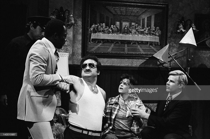 Garrett Morris as officer, John Belushi as Pablo, Gilda Radner as Carlos, Dan Aykroyd as Jimmy Carter during the 'Boulevard of Proud Chicano Cars' skit on May 12, 1979 - Photo by: