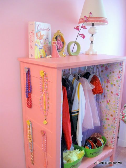 "Would love to have something like this ""pretend dress-up"" play closet, made from an old dresser, for my girl's room. Appreciate that this is a real piece of furniture that retains the dresser top as a usable flat surface and uses the sides and bottom to further organize."