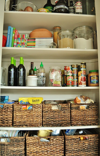 LOVE the idea of baskets in the pantry!  I hate all the loose bags of chips on the shelves.  Totally doing this!