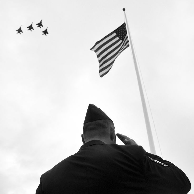 December 7th marks the anniversary of the surprise air attacks on the U.S. Naval Base at Pearl Harbor. This photo captures Master Sgt. John Sieh saluting the flag as F-15 Eagles fly in missing man formation during the 68th Remembrance Ceremony at Hickam Air Force Base, Hawaii. • This week, we salute those who served, were wounded and lost their lives during the December 7, 1941 attacks on the U.S. Naval base at Pearl Harbor.