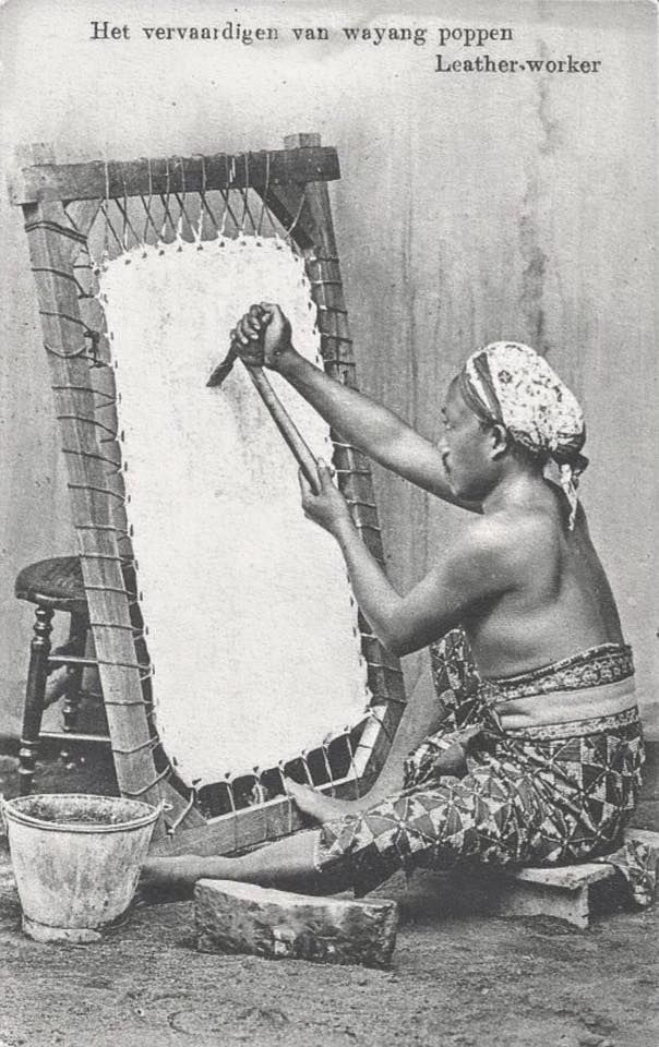 """""""The making of wayang pupets - Leather worker"""" (Java, 1910 or earlier)"""