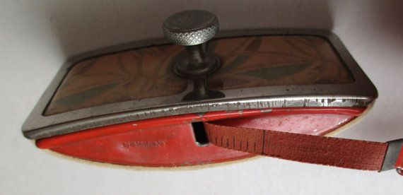 Germany Tape Measure with Lint Remover; Tin Sides; Celluloid Top; Tape in MM and Inches; Works; Marked Germany and D.R.G.M; CS7F