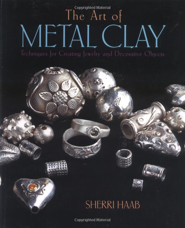 The Art of Metal Clay by Sherri Haab, displays works by Daniel Barney (Visual Arts professor)
