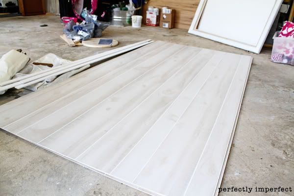 how to install faux wood paneling (aka white plank walls) We had fully intended on buying the orange-speckled laminate giant of the 70s, but when we got to Lowes, we found this whitewashed pine version instead.  At $14.98 per 4 x 8 sheet, it was a steal when compared to adding real wood to our walls!