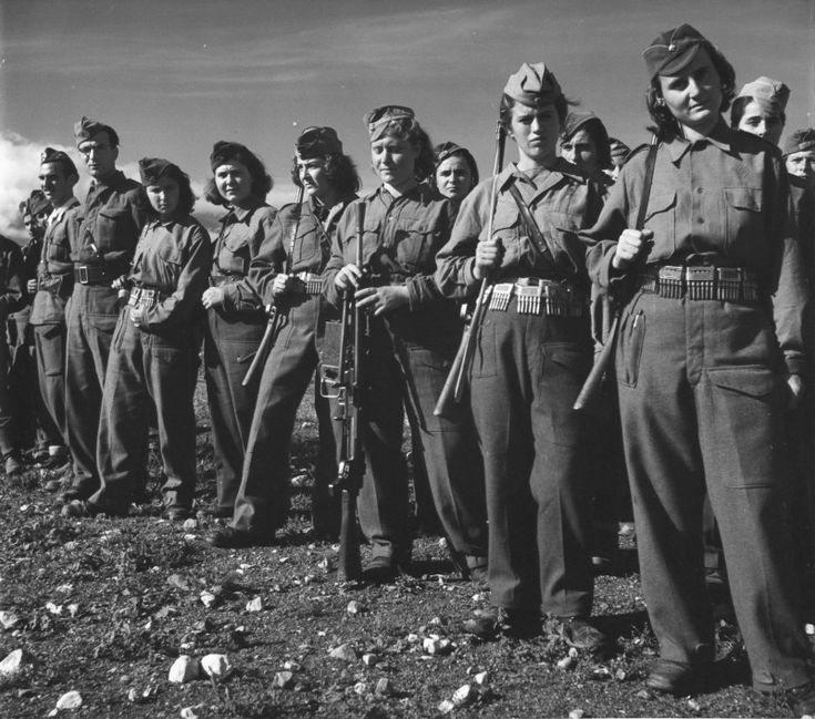 Greek guerrillas and partisans in the ranks. Girls armed with captured Italian rifles