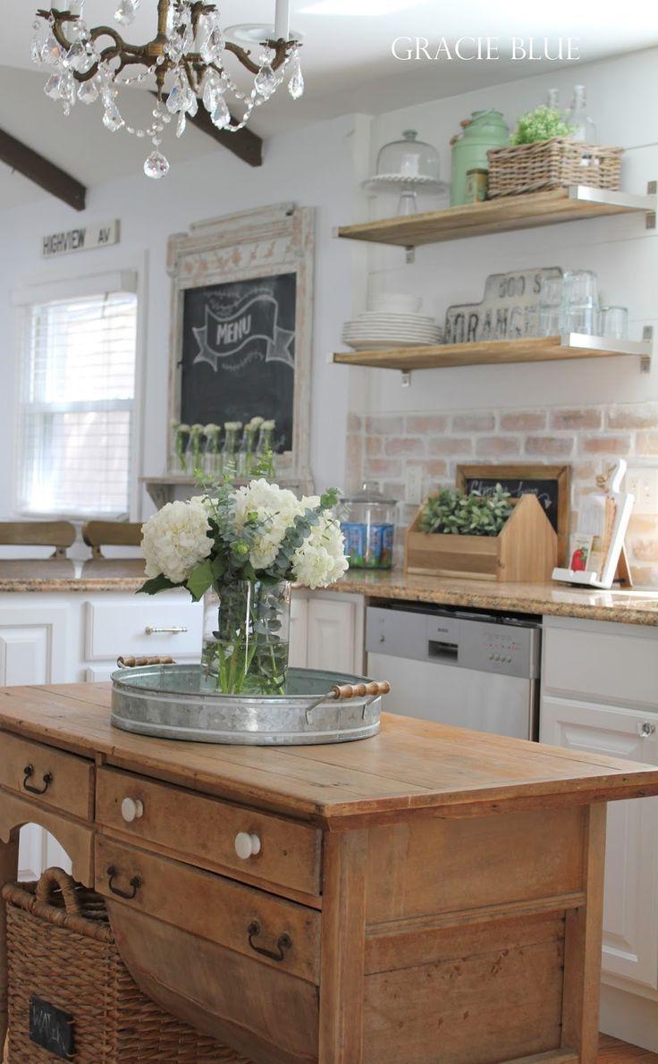 Brick backsplash wood island open shelvinglove this kitchen