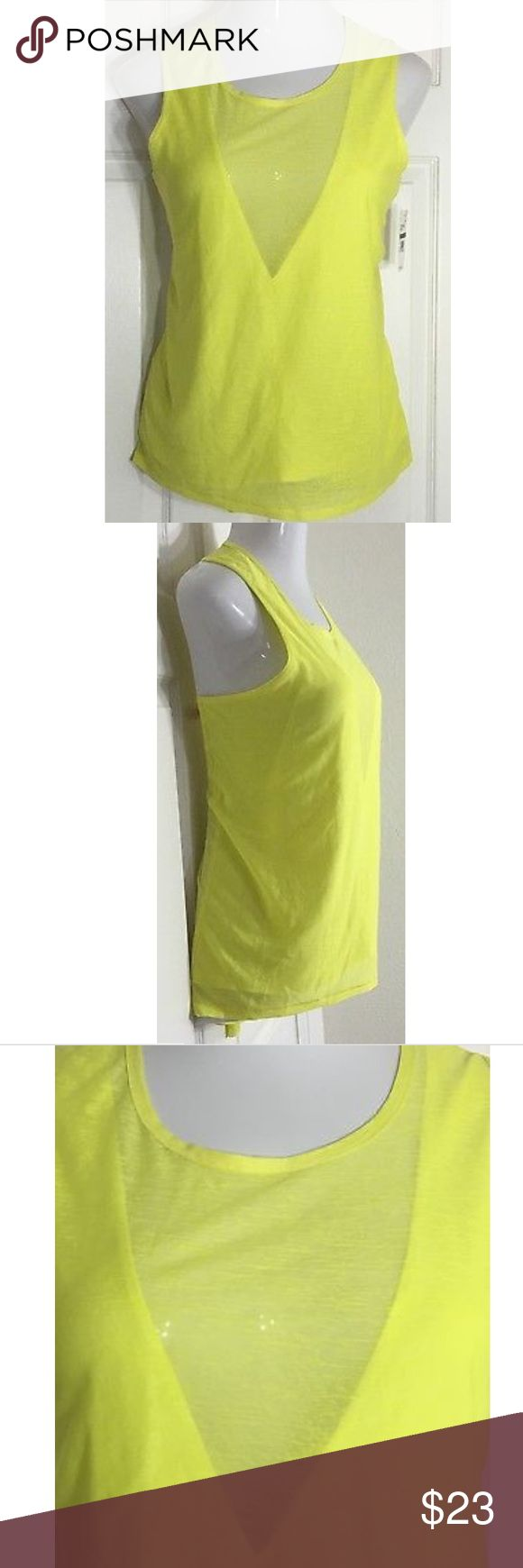 "Kiind Of Sleeveless Hi-Low Yellow Tank Top Cute yellow top! The front is partially lined. The back is semi sheer with pleats at the neckline. Bust: 40""; Length in the back from the shoulder: 25"". Smoke free home. Thank you for shopping my closet 😊🌺 Kiind Of Tops Tank Tops"