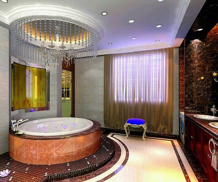 Luxury blue bench bathroom with oval bathtub and chandelier. 50 Magnificent Luxury Master Bathroom Ideas ➤To see more Luxury Bathroom ideas visit us at www.luxurybathrooms.eu #luxurybathrooms #homedecorideas #bathroomideas @BathroomsLuxury