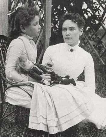 Hellen Keller, with doll, and teacher Anne Sullivan.