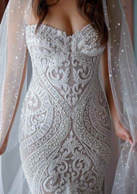 Densely beaded wedding gowns are not a problem for us.  We are a USA based dress design company that specializes in beaded wedding dresses that are reasonably priced.  In addition to custom designs we also make #replicas of haute couture bridal designs that will have the same style but cost much less.  We can work from any picture you have to create the perfect wedding gown of your dreams.  Get pricing on any design you love from the internet by contacting us directly.