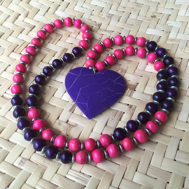 Beautiful resin heart pendant suspended on a long strand of coloured wooden beads alternated with small silver plated beads.  The combined effect is absolutely stunning!   Not to mention that the colour combinations are gorgeous meaning you are spoilt for choice with this range.