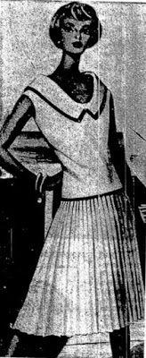 (1959) -Conjunto formado                              por saia plissada reta e blu                              são solte de mesma cor.                              Friso escuro na gola e barra                              do blusão.