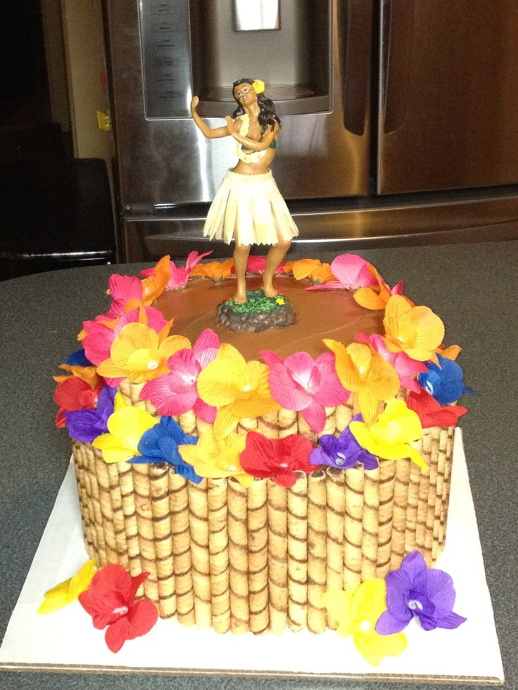 Hawaiian Birthday Party Cake. We used 4 of the 5 packs of wafers from the Costco tin. We used just a solar powered hula girl on the top with some dried pineapple flowers and crushed graham wafers for sand and a lei at the bottom. The wafers cut well with kitchen shears to make different sizes. Very simple and cute!