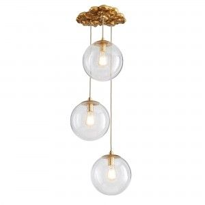 Perhaps Barry's favorite piece in this new collection, the Cloud Pendant rains three seedy glass orbs of light from a carved, antiqued gold leaf-finished cloud-like canopy that mounts onto the ceiling as a sculpture. Glamorously magical, this dynami c fixture lends Asian elan and clean geometric from to any interior, modern or traditional. Use it in any room of a home. Approved for use in covered outdoor areas. Finish may vary.