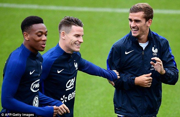 Martial, pictured with Antoine Griezmann (right) and Kevin Gameiro (centre)…