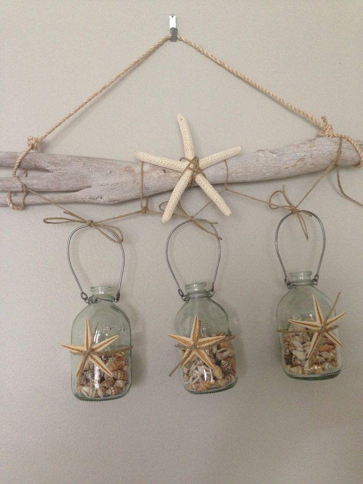 Driftwood, shells in bottles and some sea stars.