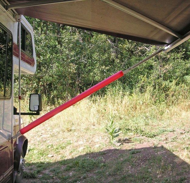 Slit foam swim noodles lengthwise and slip over each awning strut. Not only are you less likely to bump into them in the dark, but they'll be padded! - Camping Hacks