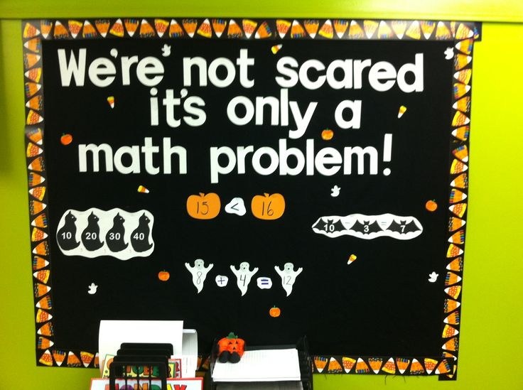 Halloween math bulletin board. They used CTP's Poppin' Patterns® Candy Corn Border. #mathbulletinboard #halloweenbulletinboard