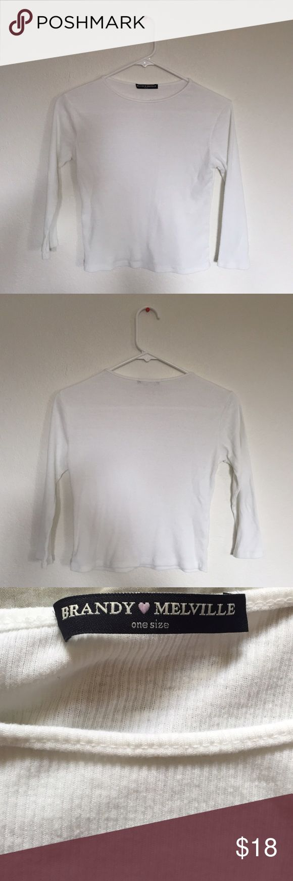 Brandy Melville White Long Sleeve Top A really cute and casual white long sleeve top. It's somewhat cropped and sleeves are about 3/4 long. Never worn and brand new. Fits xs-m! Brandy Melville Tops Tees - Long Sleeve