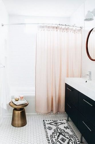 simple bathroom with blush pink curtain