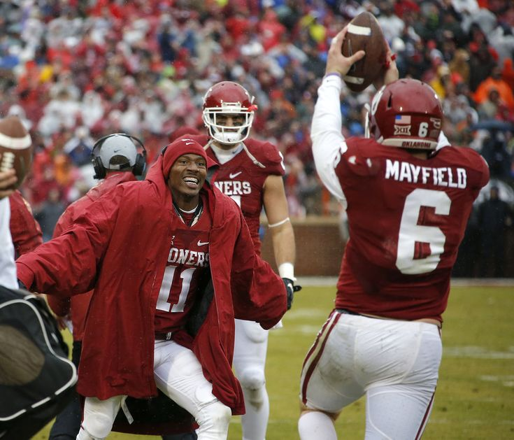 Oklahoma's Dede Westbrook (11) celebrates with Oklahoma's Baker Mayfield (6) after a Oklahoma's Joe Mixon touchdown late in the fourth quarter of the Bedlam college football game between the Oklahoma Sooners (OU) and the Oklahoma State Cowboys (OSU) at Gaylord Family - Oklahoma Memorial Stadium in Norman, Okla., Saturday, Dec. 3, 2016. Oklahoma won 38-20. Photo by Bryan Terry, The Oklahoman