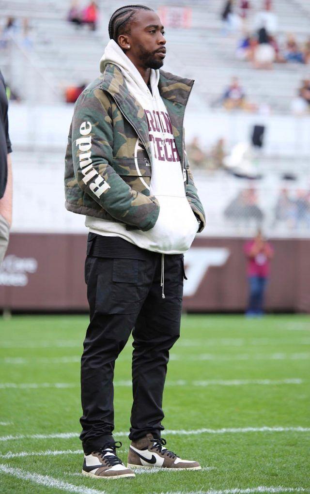 Wearing a Rhude Jacket, Rick Owens Pants, and Travis Scott x