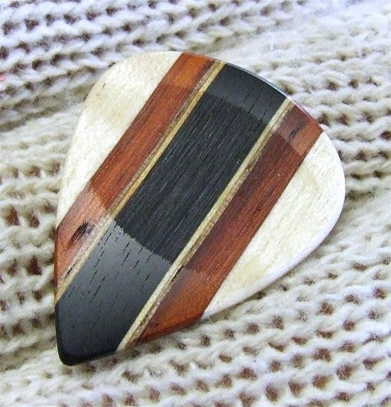 wood guitar pick ~ I don't play guitar but itd make a nice gift for someone who does!