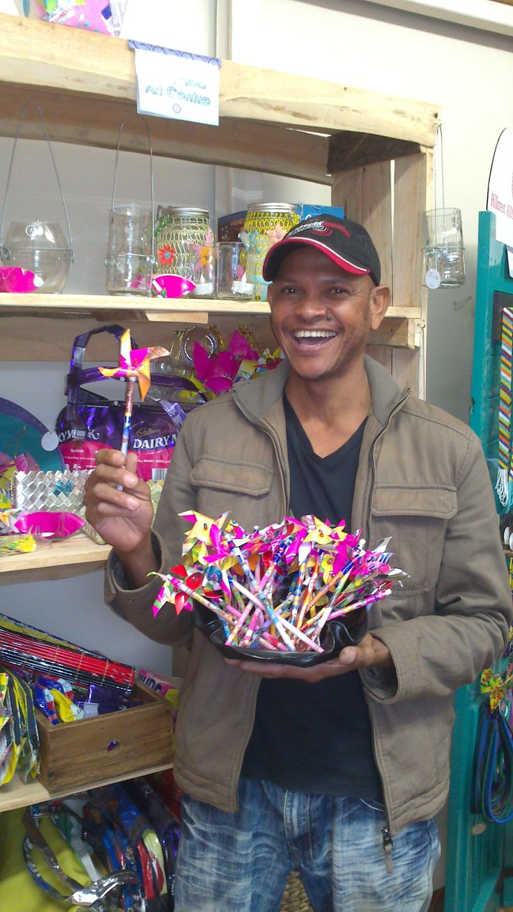 Francis Woza Moya recycling genius! Look at those little windmill pencils! www.hillaids.org.za