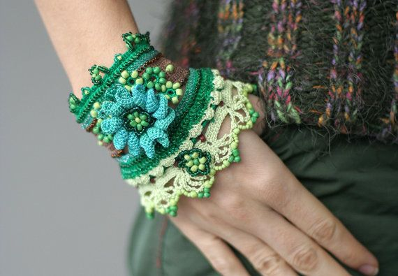 Unique handmade crochet bracelet in green, aqua and brown colors, decorated with crochet flower, glass and plastic beads, with malachite buttons. It