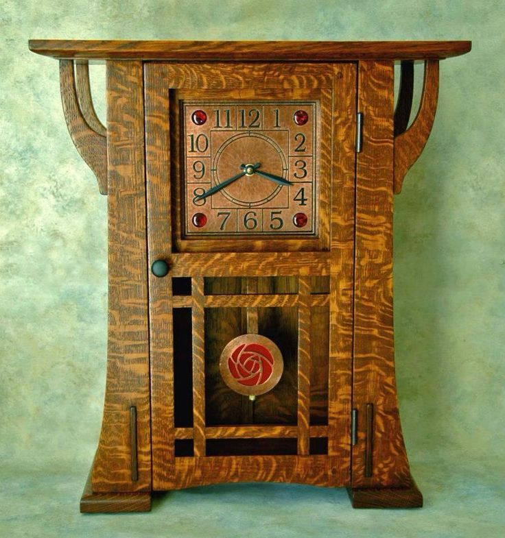 By Terry Cross from The Arts and Crafts Studio. Quarter-sawn white oak with etched, hammered copper face embellished with paua cabochons. Pendulum is copper with a Dard Hunter rose design.