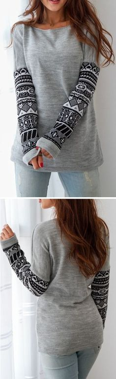 Happily grey makes casual chic again this fall. The All Day Long Sweatshirt features indian printing and fleece lining.