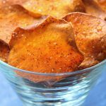 Homemade Sweet Potato Chips recipe creates lightly crisp chips perfect for snacks or nachos. Recipe uses coconut oil & chips are kissed with chili powder.