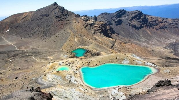 Tongariro Crossing, New Zealand: The striking, iridescent, Emerald Lakes on the otherworldly, lunar landscape of the Tongariro Crossing. Some of the Mordor sequences from Lord of the Rings were filmed here. The lakes derive their colour from their high sulphur content.