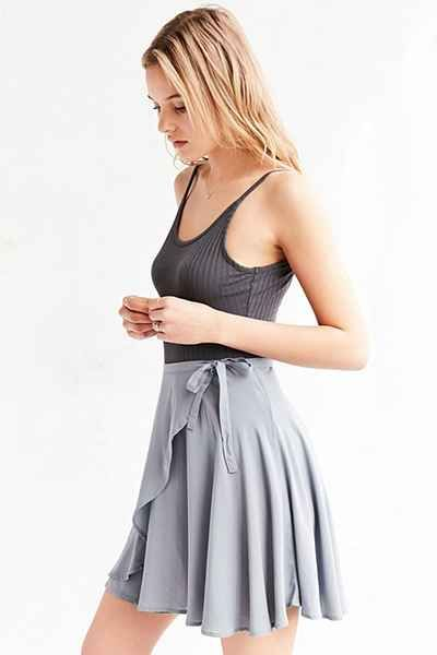 """This skirt. (Unfortunately, this Urban Outfitters Skirt is sold out right now.) Light pink ballet tights would be worn with ballet technique shoes.  I chose this color for the costumes because I feel it ties in well with the title, """"Flock""""."""