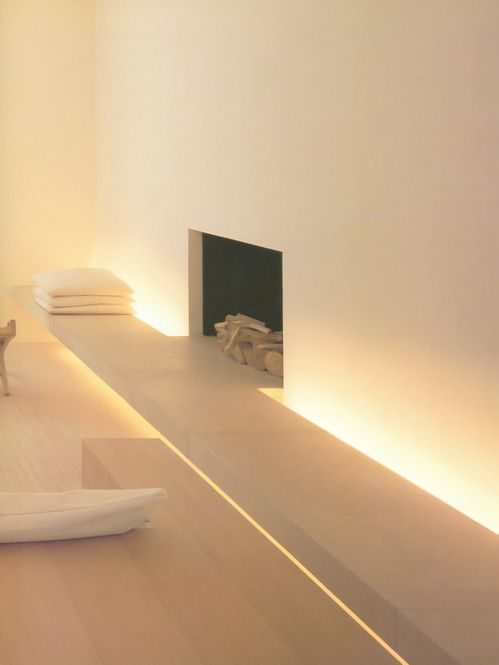 fireplace bench with gorgeous lighting - design by John Pawson