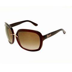 """Lunettes Gucci, by Safilo - Mode lunettes - Comme tout droit sorties d'une malle ancienne, ces lunettes Gucci remettent les grands """"carreaux"""" au goût du jour. Eternelles, avec leur monture en acétate acajou transparent..."""