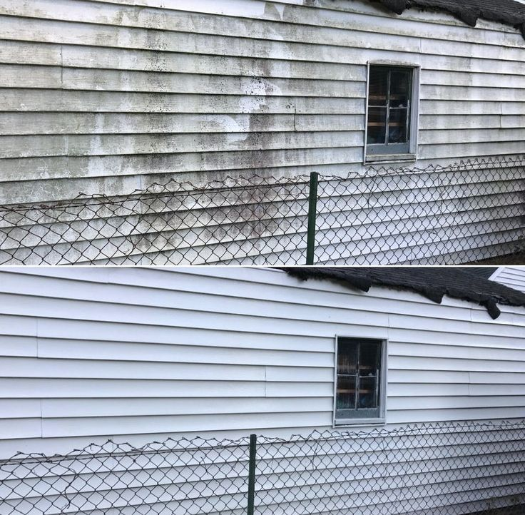 Pressure washing house siding to make it look new again.