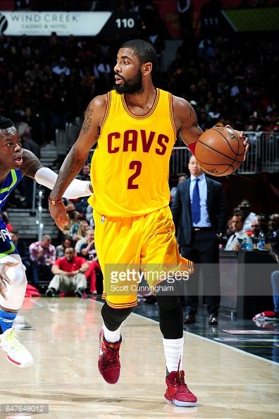 News Photo : Kyrie Irving of the Cleveland Cavaliers handles...