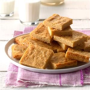 Chewy Peanut Butter Pan Squares Recipe -With seven of us in our family, including two teenage boys, these peanut butter cookie bars never last long! It's hard to believe how simple these peanut butter squares are to prepare. —Deb DeChant, Milan, Ohio